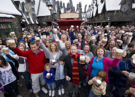 Guests drinking butterbeer